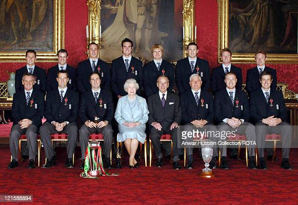 Members of England's 2005 Ashes winning Cricket team sit with Britain's Queen Elizabeth II and the Duke of Edinburgh in Buckingham Palace London...
