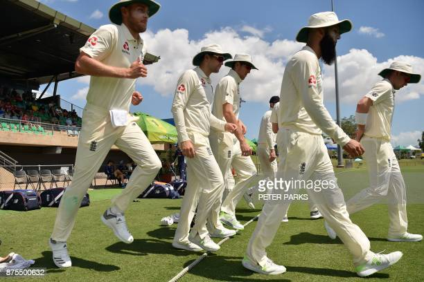 Members of England's cricket team head onto the field to play Cricket Australia XI on the fourth and final day of their fourday Ashes tour match at...