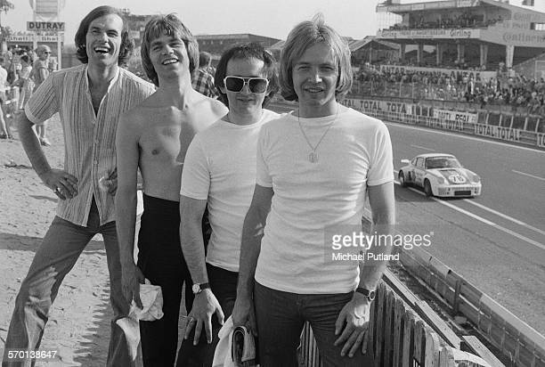 Members of English pop group The Rubettes at the 24 Hours of Le Mans France 12th13th June 1976 Left to right bassist Mick Clarke drummer John...