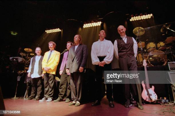 Members of English rock group King Crimson including from left guitarist Robert Fripp drummer Bill Bruford drummer Pat Mastelotto guitarist Adrian...