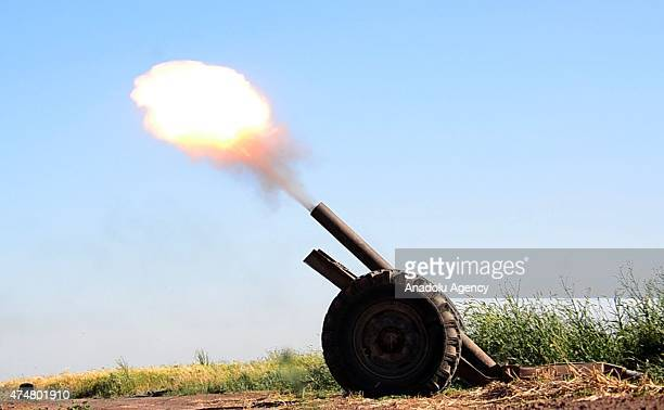 Members of EsSamiyye Front fire artillery loaded with a howitzer as they attack the Daesh militants near the Tel Melid village of Damascus Syria on...