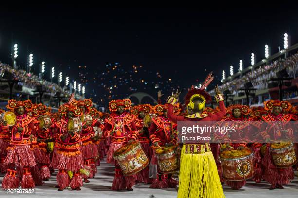 Members of Estacio De Sa samba school perform during the first night of 2020 Rio's Carnival Parades at the Sapucai Sambadrome on February 23, 2020 in...