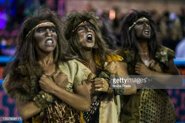 Members of Estacio De Sa samba school perform during the first night of 2020 Rio's Carnival Parades at the Sapucai Sambadrome on February 23 2020 in...