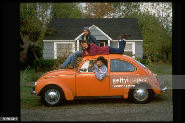 Members of Eugene Car CoOp sharing orange 1972 volkswagen Beetle members pay membership fees share insurance can rent this car for 50 cents an hour...