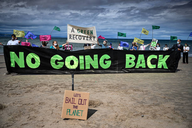 GBR: Extinction Rebellion Hold Heads In The Sand Protest At Nairn