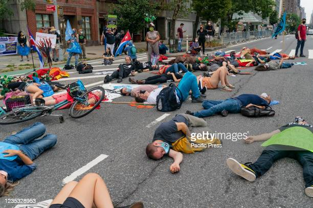 Members of Extinction Rebellion stage protest against companies supporting oil, gas and minerals extractions from Earth to mitigate climate change on...
