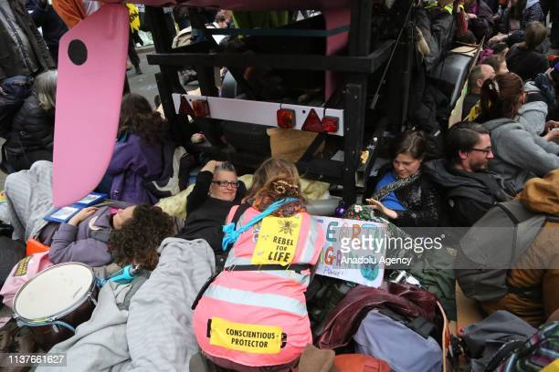 Members of Extinction Rebellion , which is a socio-political movement to avert climate breakdown, halt biodiversity loss, and minimize the risk of...