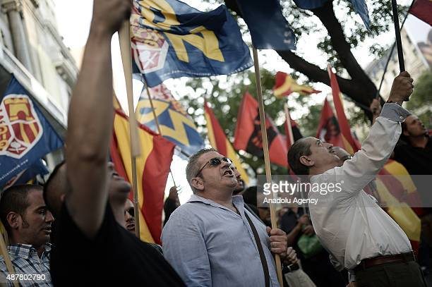 Members of extreme nationalist political group Falange stage a protest against Catalan independence in Madrid Spain on September 11 2015