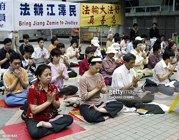 Members of Falun Gong stage their protest outside the Hong Kong Immigration Department 29 April 2004 The protest urged Chinese authorities to release...