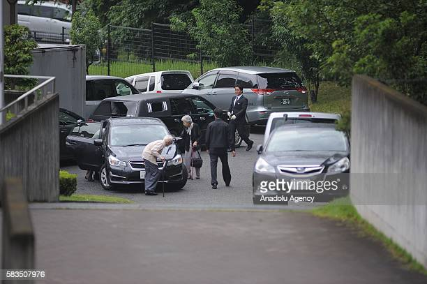 Members of family of people killed are seen on the site where Satoshi Uematsu killed 19 and wounding 25 in a knife attack in a residential care for...
