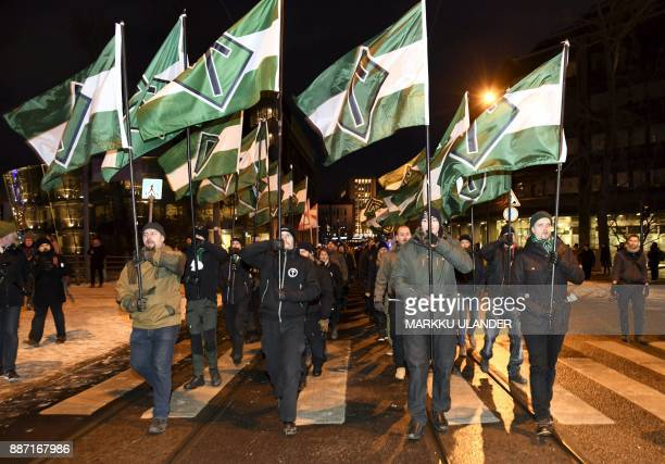Members of far right group Nordic Resistance Movement march during the festivities of the centenary of Finnish independence in Helsinki Finland on...