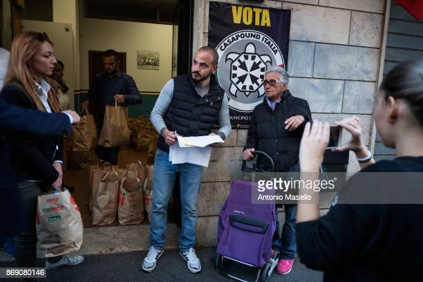 Members of Farright movement Casapound hand up Twohundred food bags for Italian people with economic difficulties in Ostia suburb of Rome on November...