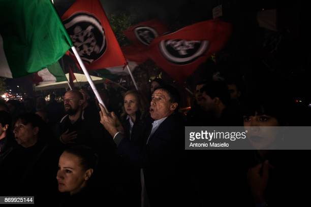 Members of farright movement Casapound wave flags during the closing act of the electoral campaign for presidency of Ostia's city hall suburb of Rome...