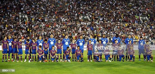 Members of FC Barcelona stand at midfield prior to the start of the friendly soccer match against the Los Angeles Galaxy at the Rose Bowl on August 1...