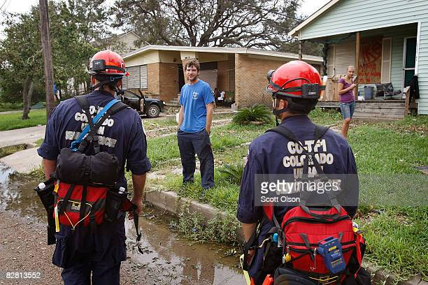 Members of FEMA's Colorado Urban Search and Rescue team check on residents who did not evacuate before Hurricane Ike's arrival September 14 2008 in...