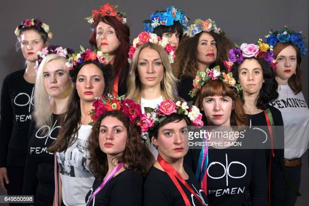 TOPSHOT Members of feminist activist group Femen pose on March 5 2017 in Paris Foreground LtoR Julia Naccache Constance Lefèvre and Sarah Constantin...