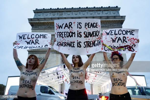 TOPSHOT Members of feminist movement Femen demonstrate in front of the Arc de Triomphe on November 10 as several leaders are to arrive in Paris on...