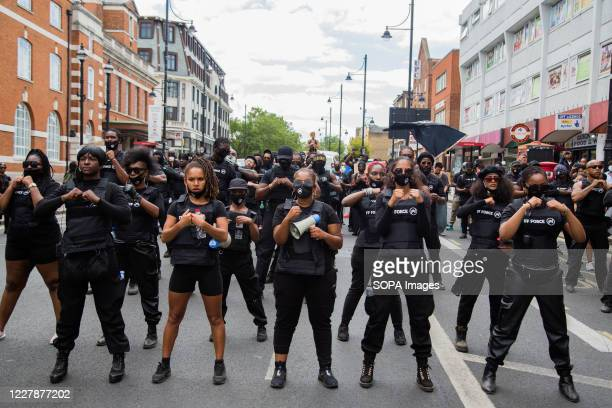 Members of FF Force AKA Forever Family chant slogans outside Brixton town hall during the annual Emancipation day. Emancipation Day marks the...