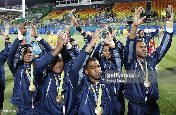 Members of Fiji's men's rugby sevens team acknowledge the crowd after beating Britain 437 to claim the first ever sevens gold and the island's first...