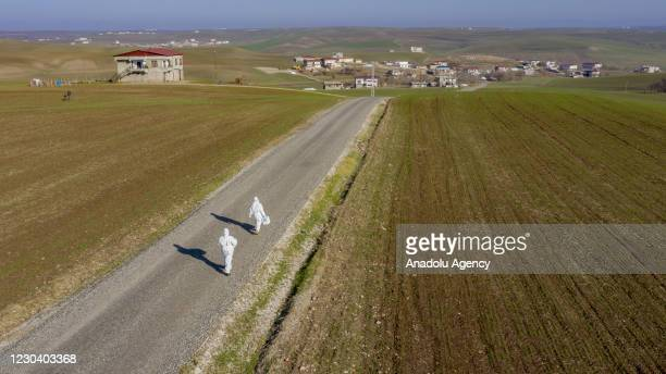 Members of filiation teams are seen going to rural areas in Turkey's Diyarbakir province, on January 03, 2021. The filiation teams working to...