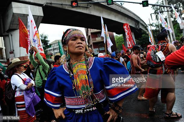 Members of Filipino indigenous tribes perform a ritual dance as protest against the Asia Pacific Economic Cooperation summit near the presidential...