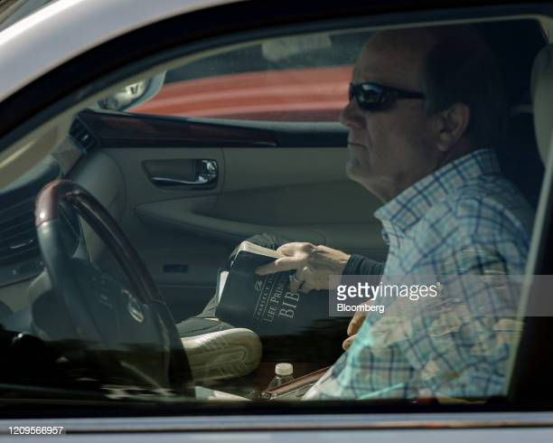 Members of First Baptist Church sit in vehicles during a worship service at First Baptist Church in West Memphis, Arkansas, U.S., on Sunday, April 5,...