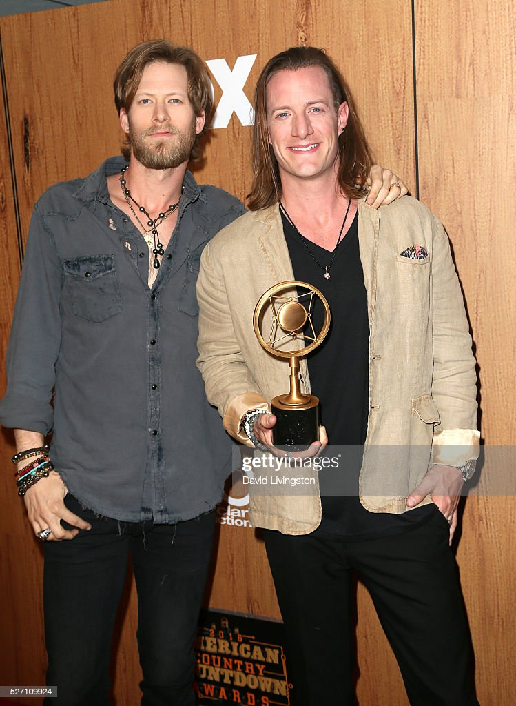 Members of Flordia Georgia Line Brian Kelley (L) and Tyler Hubbard pose in the press room with the Group/Duo of the Year award at the 2016 American Country Countdown Awards at The Forum on May 01, 2016 in Inglewood, California.