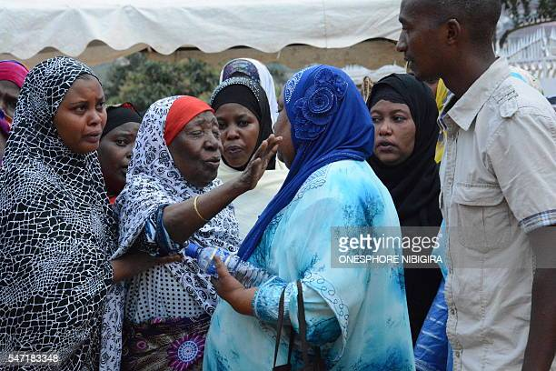 Members of former Burundian minister Hafsa Mossis family mourn at her funeral in Bujumbura on July 13 2016 Former Burundian government minister and...