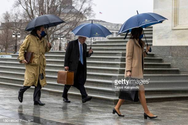 Members of former President Donald Trumps defense team Bruce Castor and Michael van der Veen arrive at the US Capitol on February 13, 2021 in...