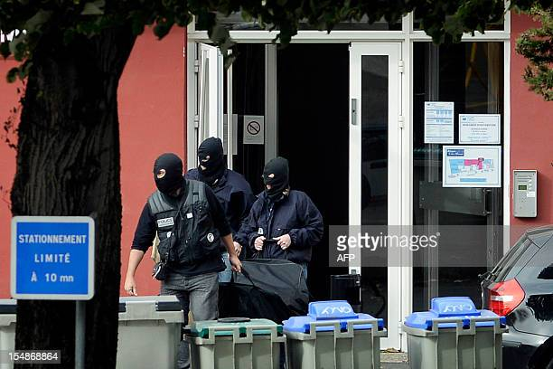 Members of France's RAID antiterrorism police unit leave on October 28 in Macon central France the residence after they arrested a suspected leader...