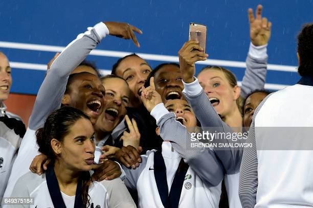 TOPSHOT Members of France's team celebrate after defeating the United States to win the She Believes Cup at RFK Stadium March 7 2017 in Washington DC