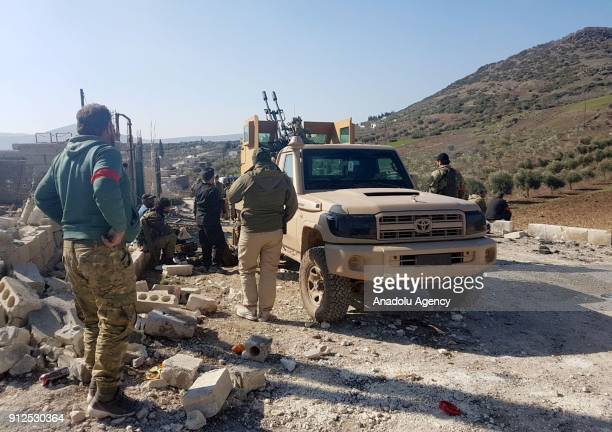 Members of Free Syrian Army are seen after Turkish Armed Forces and FSA liberated the village of Bak Ubasi in Syrias northwestern Afrin region from...