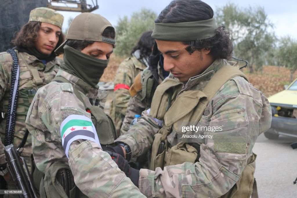 Members of Free Syrian Army (FSA) are seen as they cleared and ceased Syrian border line from PYD/PKK terrorists within the 'Operation Olive Branch' together with Turkish Armed Forces in Afrins Sharran district of Zaytuna village of Syria on February 20, 2018. Since the beginning of the operation, 78 different strategic areas have been captured from the clutches of terrorists. Turkey launched Operation Olive Branch on January 20 in Syrias northwestern Afrin region; the aim of the operation is to establish security and stability along Turkish borders and the region as well as to eliminate PKK/KCK/PYD-YPG and Daesh terror groups, and protect the Syrian people from the oppression and cruelty of terrorists.
