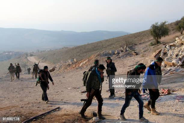 Members of Free Syrian Army backed by Turkish Army are seen after Turkish Armed Forces and Free Syrian Army cleared Dikmetas village in the town of...