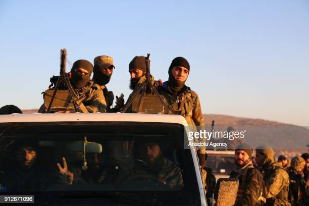 Members of Free Syrian Army backed by Turkish Army are seen after the highest points of Kurni Mountains were captured within the 'Operation Olive...
