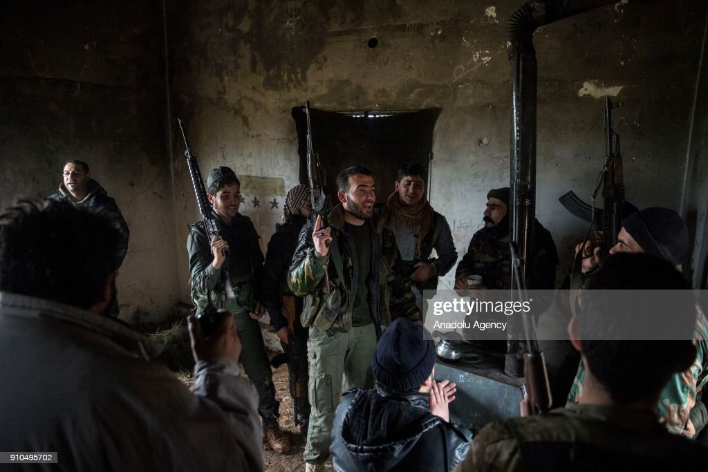 Members of Free Syrian Army (FSA), backed by Turkish Army, chant revolutionary songs in a building in Azez region of Aleppo, Syria within the 'Operation Olive Branch' against PYD/PKK in Afrin, on January 26, 2018. Turkey launched Operation Olive Branch on January 20, 2018 at 5 p.m.(1400GMT) in Syrias northwestern Afrin region; the aim of the operation is to establish security and stability along Turkish borders and the region as well as to eliminate PKK/KCK/PYD-YPG and Daesh terror groups, and protect the Syrian people from the oppression and cruelty of terrorists.