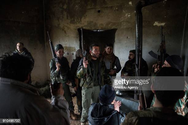 Members of Free Syrian Army backed by Turkish Army chant revolutionary songs in a building in Azez region of Aleppo Syria within the Operation Olive...
