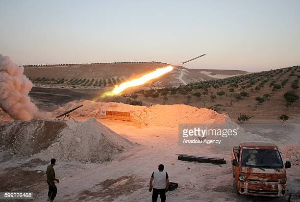 Members of Free Syrian Army carry out an attack to Assad Regime forces with missiles near Maan town of Hama Syria on September 4 2016