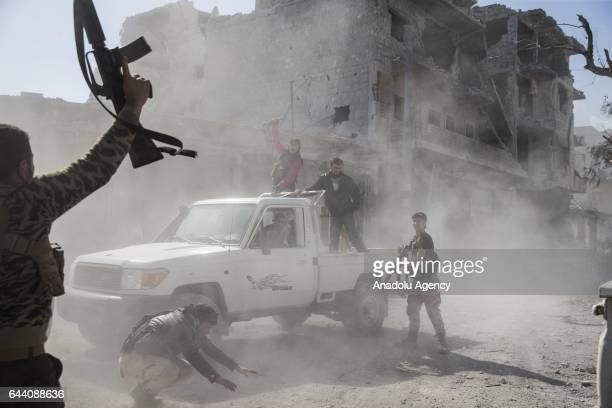Members of Free Syrian Army celebrate in Syria's Al Bab after taking control of the district's centrum from Daesh terrorists during the Operation...