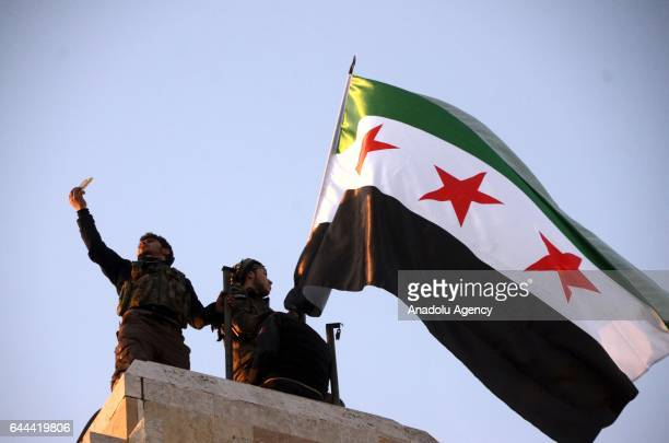 Members of Free Syrian Army celebrate their victory in the Syrian town of Al Bab after the town center has been entirely freed from Daesh terrorists...