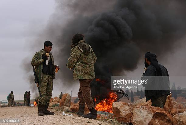 Members of Free Syrian Army make preparations before attacking Daesh terrorists' positions with heavy artillery and move forward toward center of...