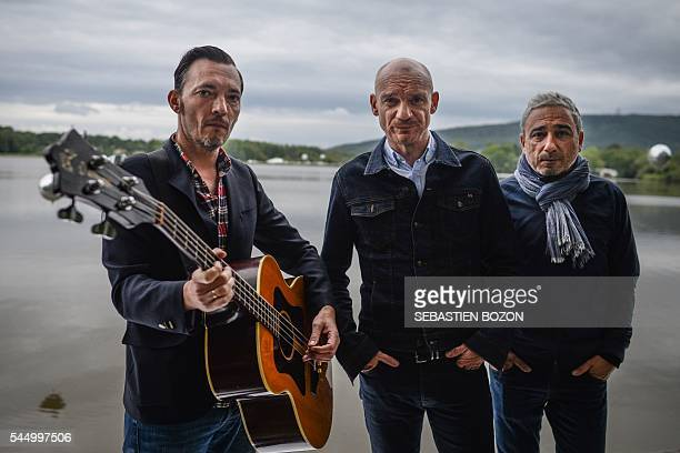 Members of French band Louise Attaque Arnaud Samuel Gaetan Roussel and Robin Feix pose during the 28th Eurockeennes rock music festival on July 2...