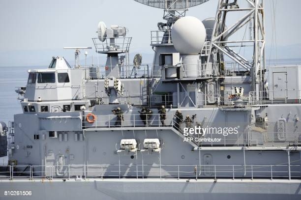 Members of French commando group Hubert take part in a drill aboard the frigate Jean de Vienne at sea off Toulon southern France on July 7 2017 / AFP...