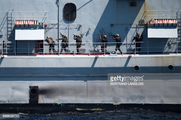 Members of French commando Hubert take part in a drill aboard the Montcalm vessel at sea off Toulon southern France as part of her visit to a French...