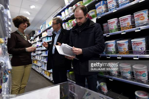Members of French General Directorate of Competition Policy Consumer Affairs and Fraud Control check baby milk products in a pharmacy on January 11...