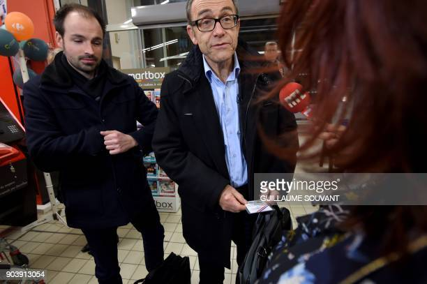 Members of French General Directorate of Competition Policy Consumer Affairs and Fraud Control arrive to check baby milk products in a supermarket in...