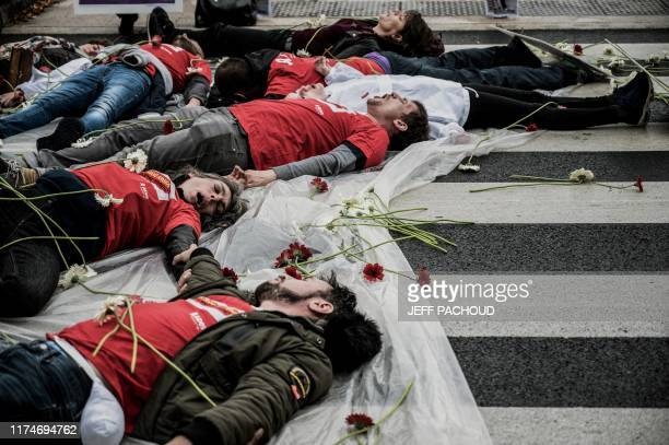 Members of French NGO Aides protest outside the venue of Sixth Replenishment Conference of the Global Fund to Fight AIDS, Tuberculosis and Malaria,...