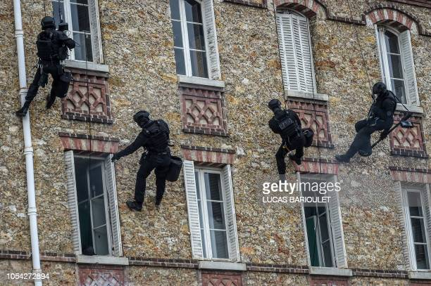 Members of French Research Assistance Intervention Deterrence Police Unit practice during the visit of French Interior Minister in the headquarters...