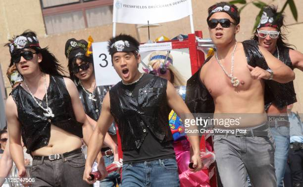 Members of Freshfields Bruckhaus Deringer run to the finish point during The 2011 Sedan Chair Race Bazaar at Matilda International Hospital in The...