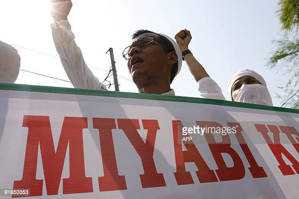 Members of Front Pembela Islam or Islamic Defender Front raise their hands during a protest against the plan of Japanese pornstar Miyabi visit to...